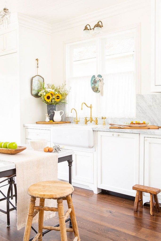 Brass fixtures and accessories help this kitchen stay true to it's Victorian farmhouse roots.