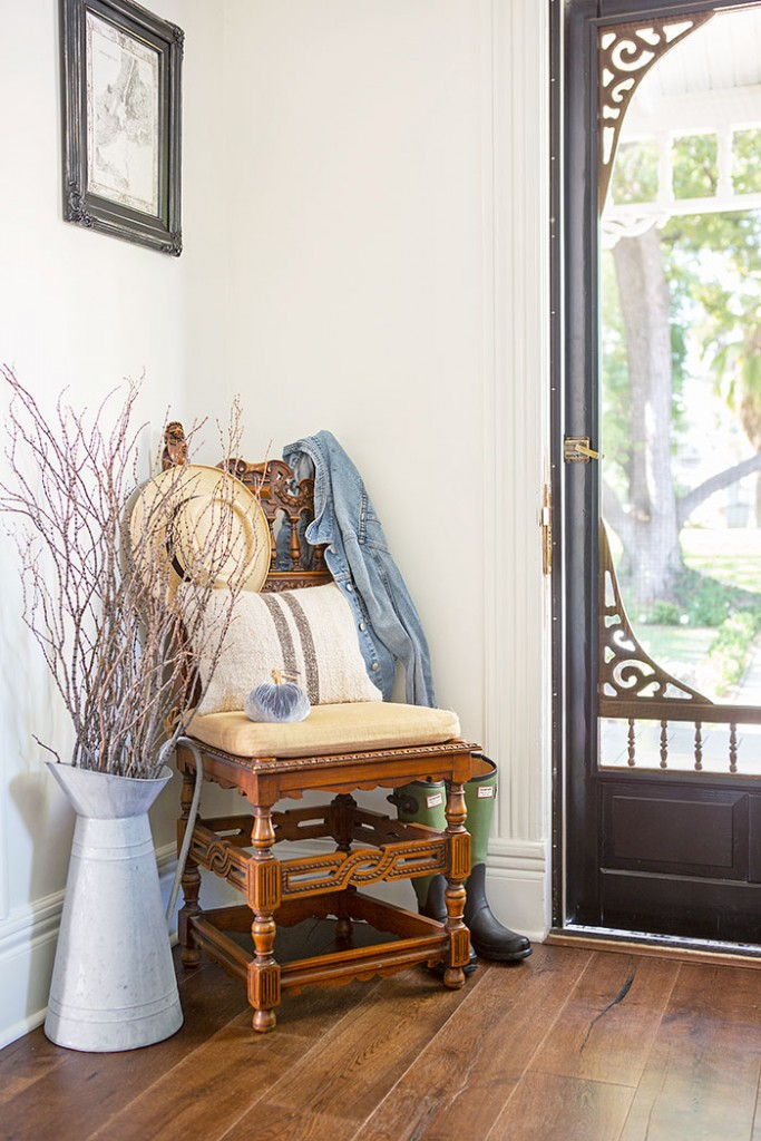 Entryway chair in a victorian farmhouse, decorated for fall