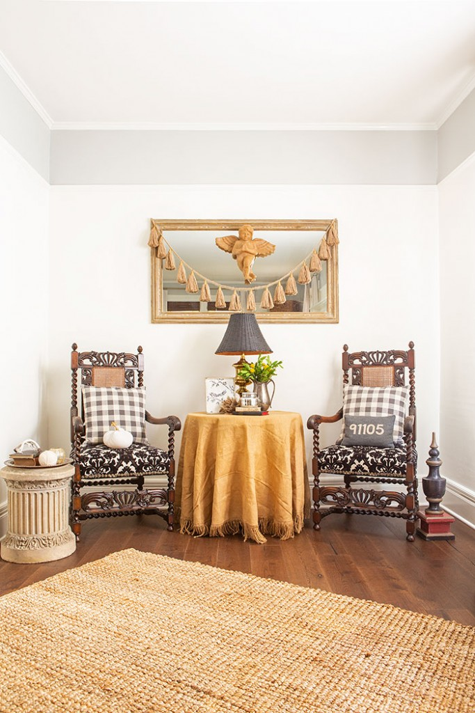 Earthy, fall tones and old fashioned patterns like gingham add a comfortable quality to this Victorian farmhouse