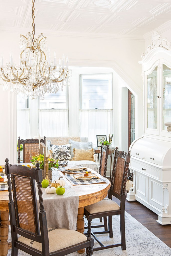 An antique oak dining set adds rustic appeal to this Victorian Farmhouse.