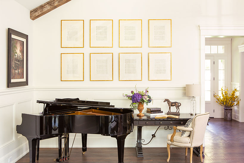 Framed music sheets by a grand piano