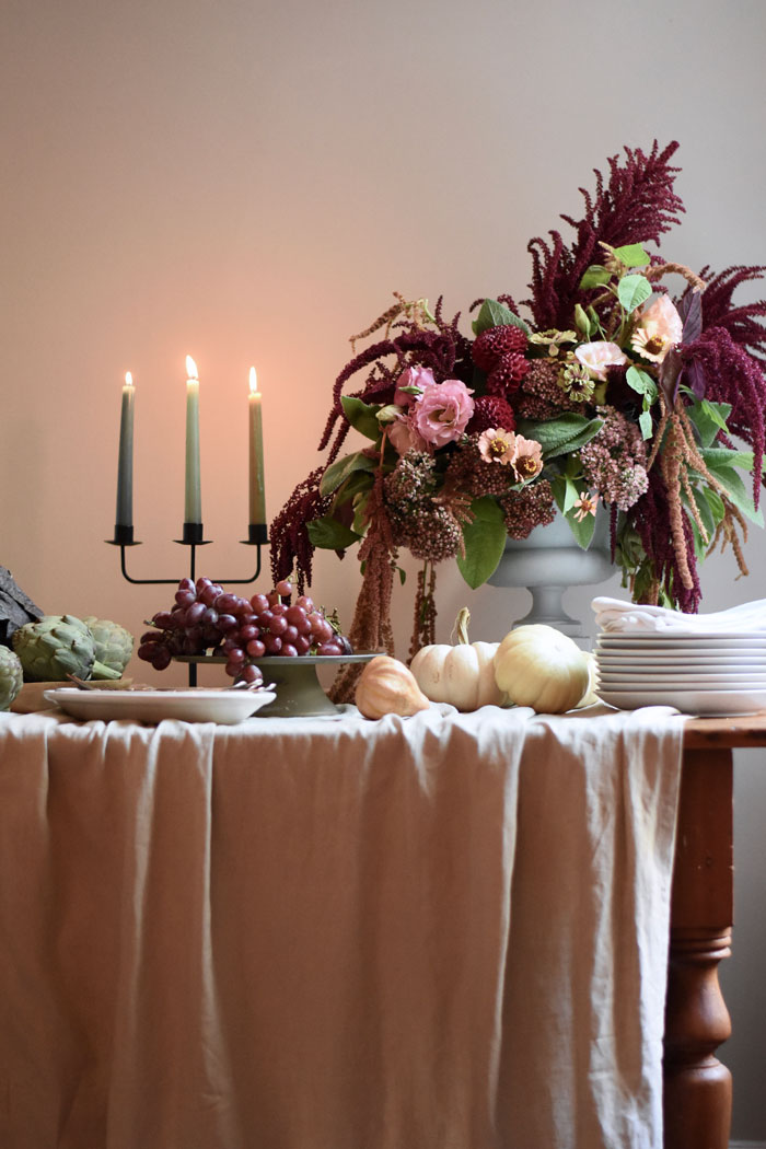 Vintage ironstone hotelware, harvest fruits and vegetables and a fall floral arrangement are perfect for fall table decor