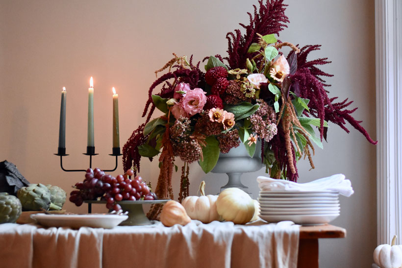 A favorite place to find décor items is no further than your refrigerator. Everyday household staples like fall fruit and vegetables add a rustic country look to your table.