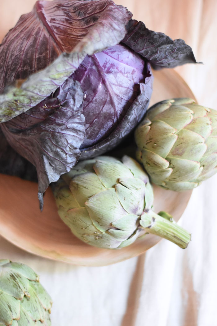 Artichokes and purple cabbage add texture, interesting shape and beautiful autumn hues to fall table decor